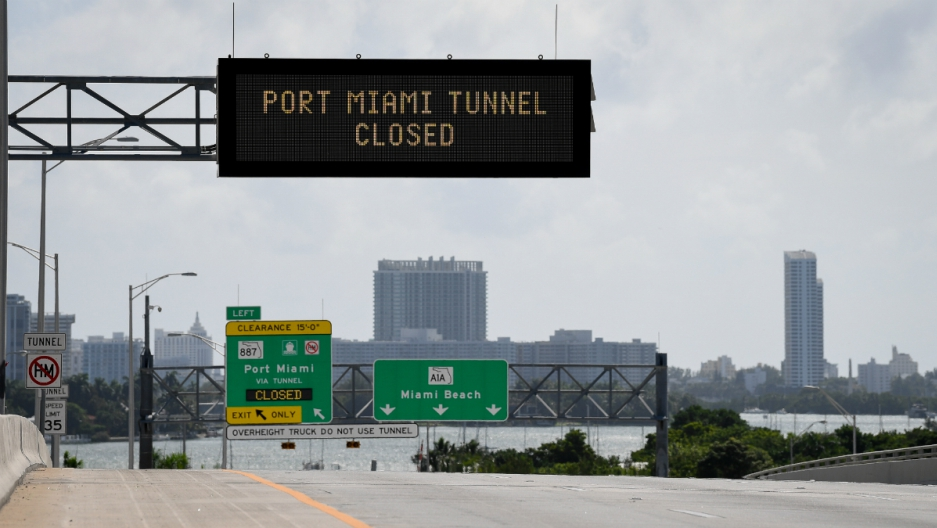 Signs warning of road closures are seen above the road in Miami Beach, Florida, U.S., September 8, 2017.