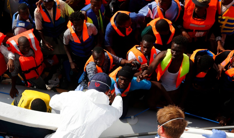 Migrants attempting to cross the Mediteranean being assisted by MOAS.