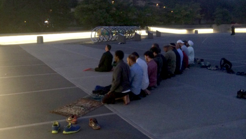 California Muslims praying on a hilltop in Berkeley.