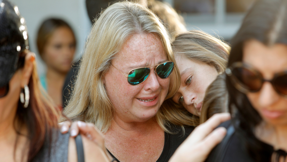 Mourners react during a community prayer vigil for victims of yesterday's shooting at nearby Marjory Stoneman Douglas High School in Parkland, at Parkridge Church in Pompano Beach, Florida, Feb. 15, 2018.