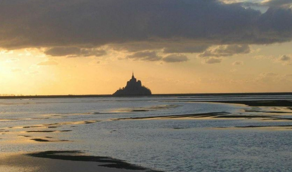 Ocean tides surround Mont Saint-Michel, the Benedictine abbey that's perched on a rocky islet.