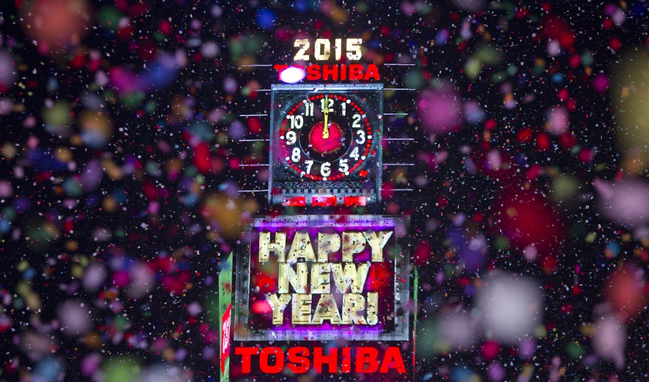 Confetti flies around the ball and countdown clock in Times Square on New Year's Eve in New York January 1, 2015.