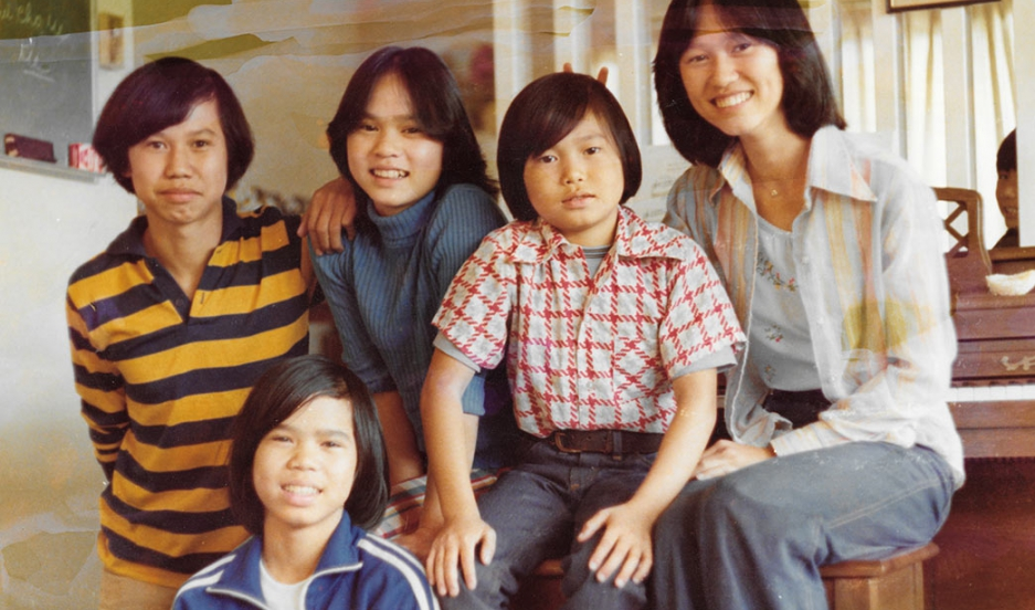 The Truong family arrived to the United States not long after fleeing Vietnam in 1975, when the then-capital of South Vietnam, Saigon, fell to the North Vietnamese army. Thu-Thuy Truong, far right, places bunny ears above her brother, Sy.