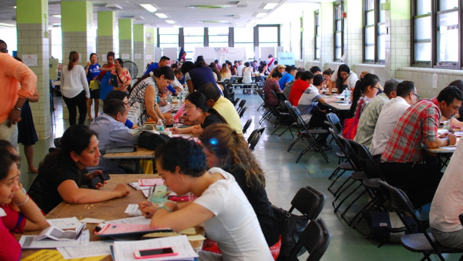 Nepali immigrants registerf or TPS at a clinic at highschool in Queens organized by Adhikaar last March.