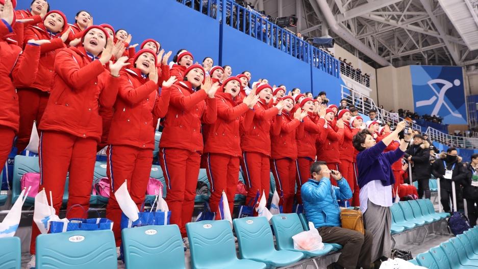 North Korean cheerleaders root for the joint Korean women's hockey team.