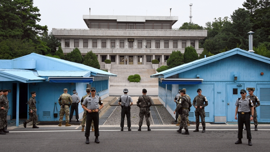 South Korea and US soldiers stand guard during a commemorative ceremony for the 64th anniversary of the Korean armistice at the truce village of Panmunjom in the Demilitarized Zone dividing the two Koreas July 27, 2017.