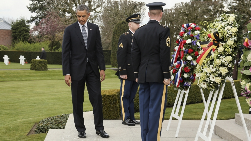 U.S. President Barack Obama attends a wreath-laying ceremony at the Flanders Field American World War I Cemetery and Memorial in Waregem March 26, 2014. Obama is on a one-day visit to Belgium where he will attend a EU-USA summit and hold a speech.