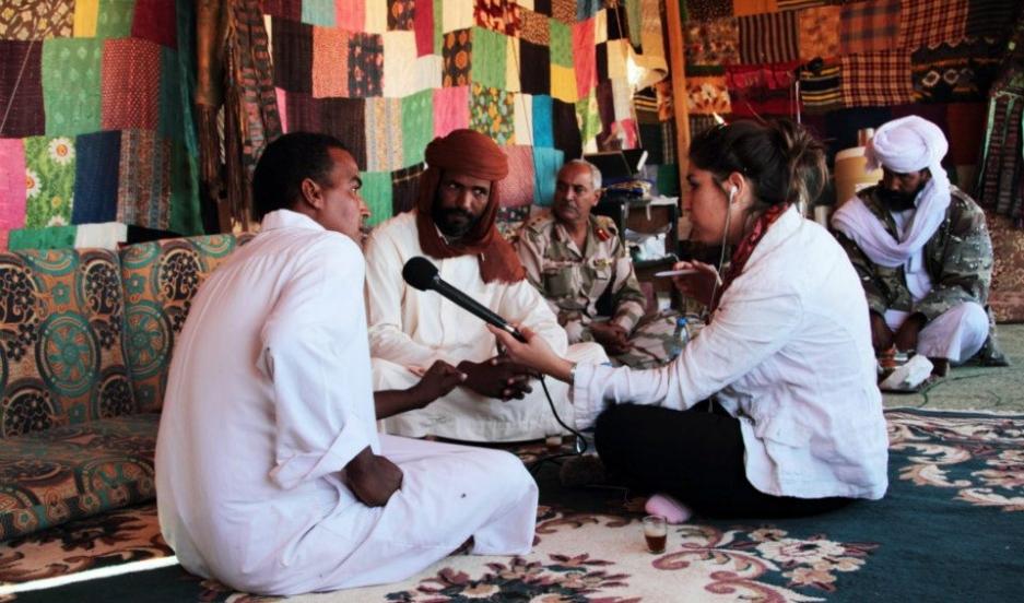 Marine Olivesi reporting in Libya in 2012.