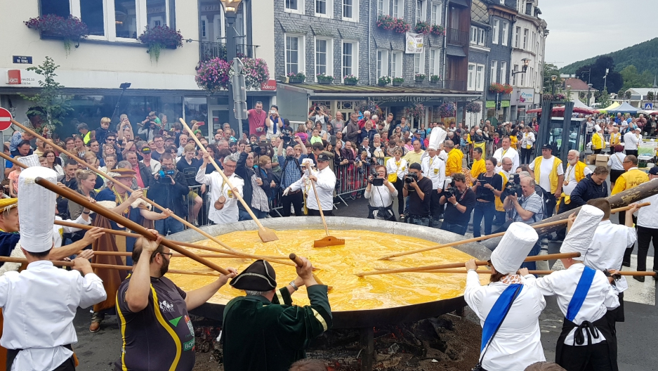 Members of the worldwide fraternity of the omelette prepare a traditional giant omelette