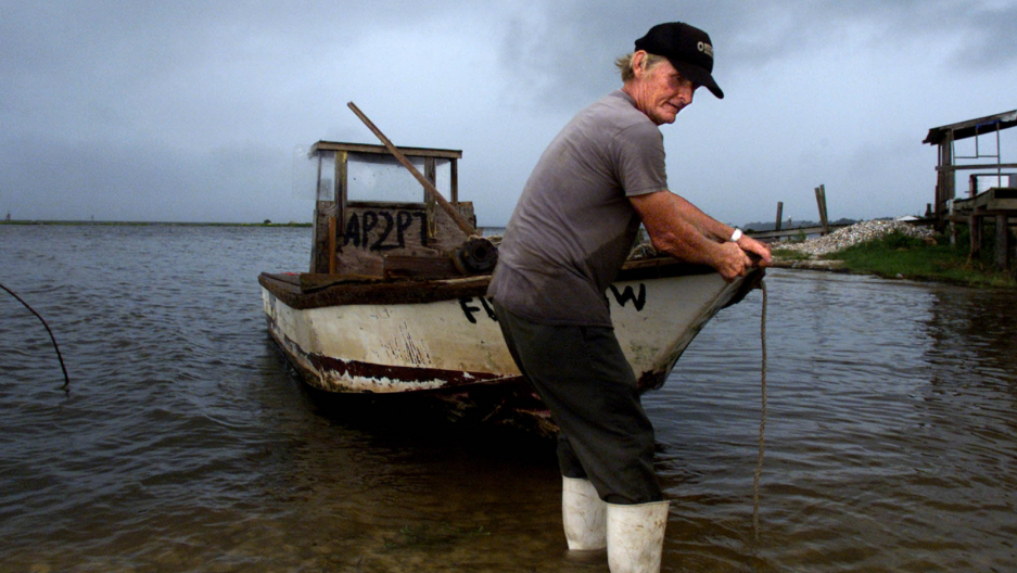 Commercial oyster fisherman Charles King prepairs to pull his aging oyster boat from the rich oystering waters of Apalachicola Bay.
