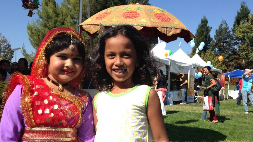 Dancers relax after performing during a Diwali Festival in Silicon Valley