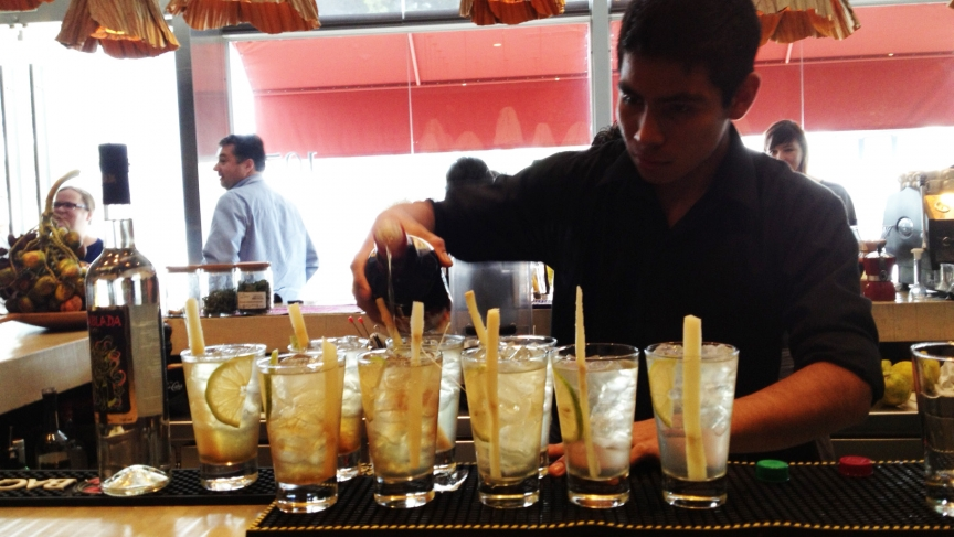 A bartender at a Lima restaurant whips up one of Peru's signature pisco cocktails