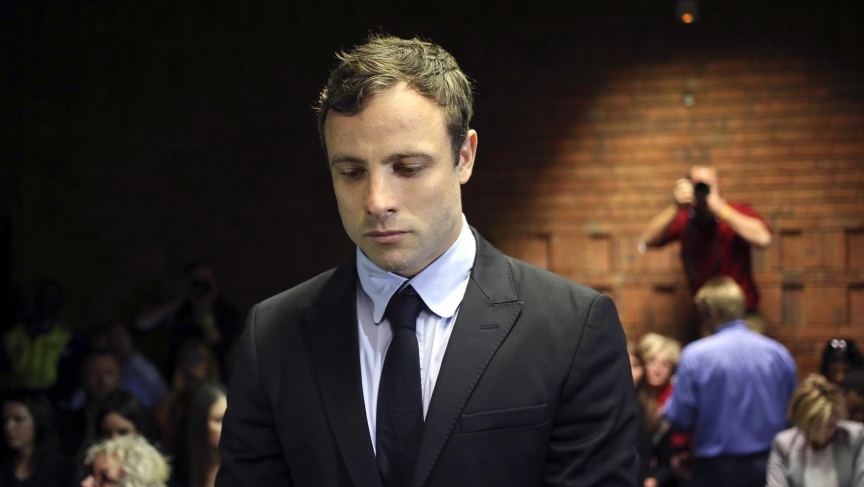 Olympic and Paralympic running star Oscar Pistorius stands during court proceedings at the Pretoria Magistrates court.