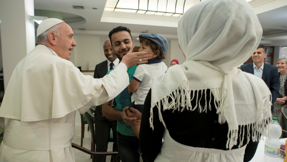 Pope Francis greets some Syrian refugees at the Vatican August 11, 2016.