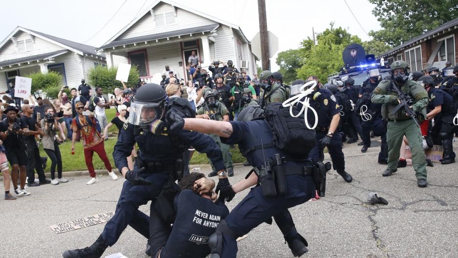 Police scuffle