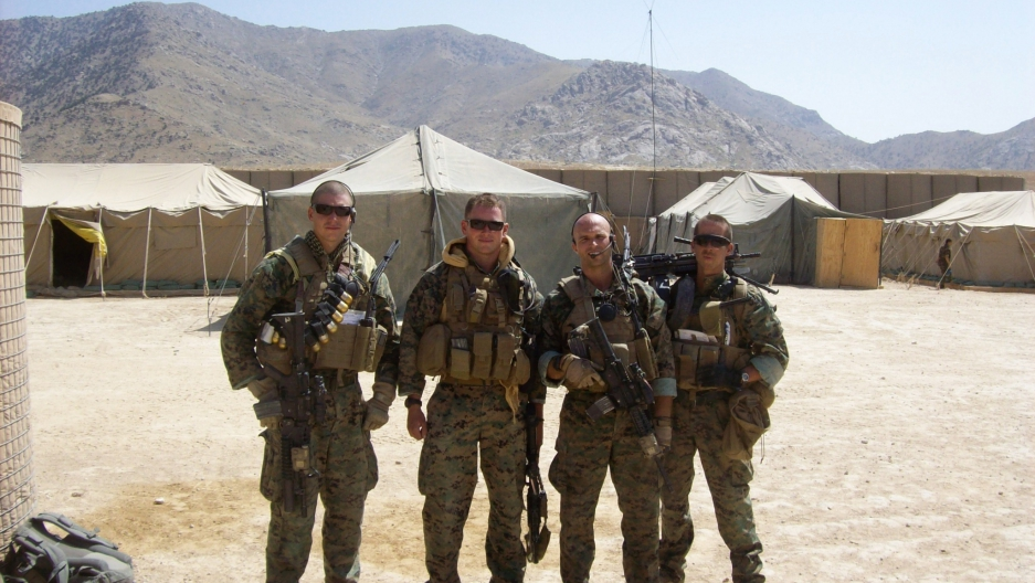 A US Marines Embedded Training Team post patrol aboard Combat Outpost Rocco, Afghanistan, 2009