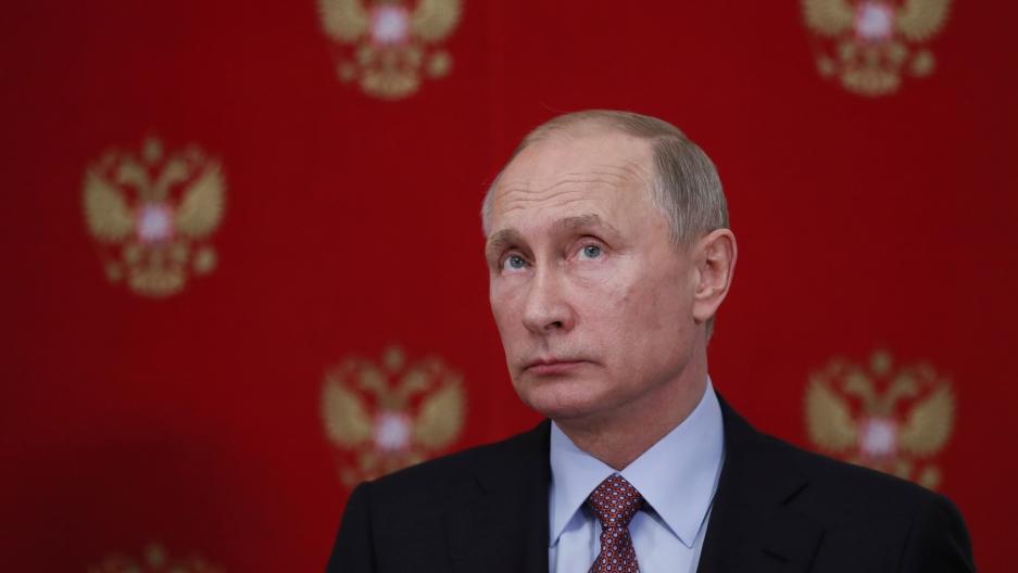 Russian President Vladimir Putin attends a joint news conference with German President Frank Walter Steinmeier
