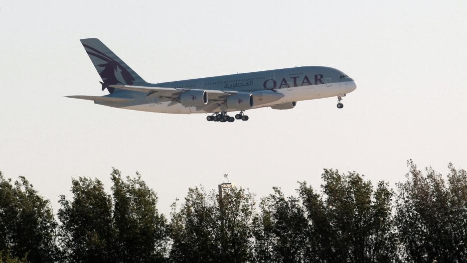 A Qatar Airways plane is seen over Doha, Qatar, June 5, 2017.