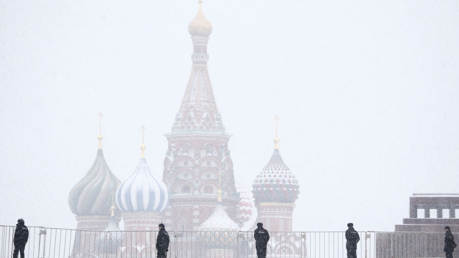 Police block access to the Red Square during a snowfall