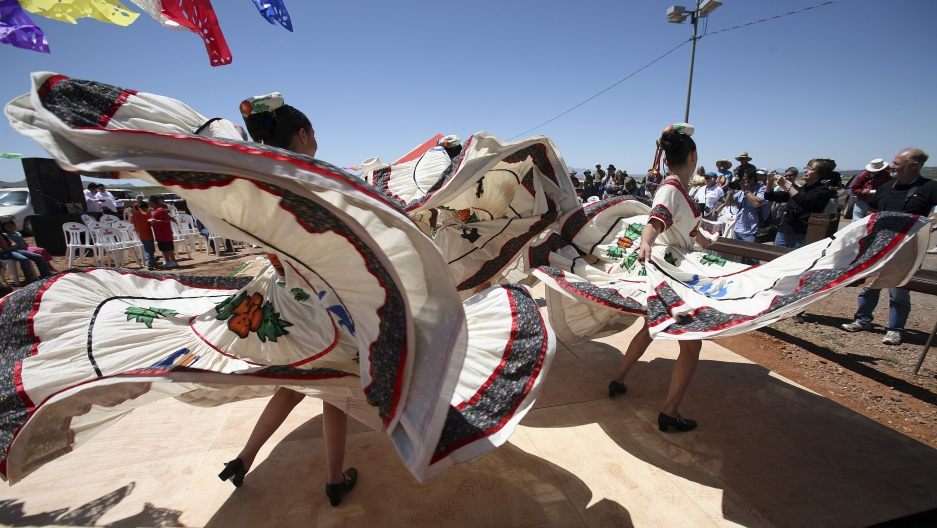 Members of a folklorico dance group from Agua Prieta, Sonora, Mexico, perform