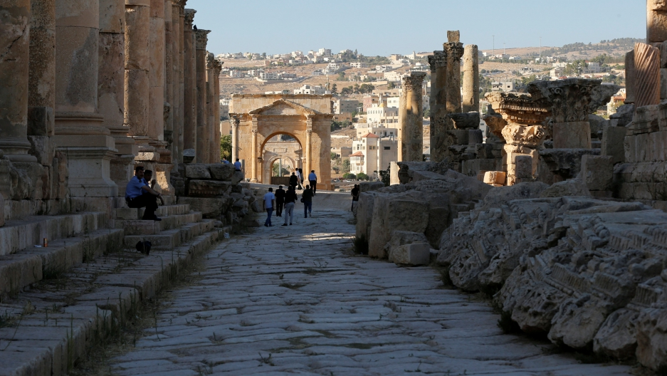 People walk along the ruins of the ancient Roman city of Jerash