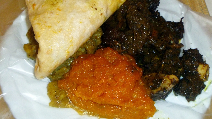 Dhalpurie roti served with pumpkin, potato and goat meat curry.