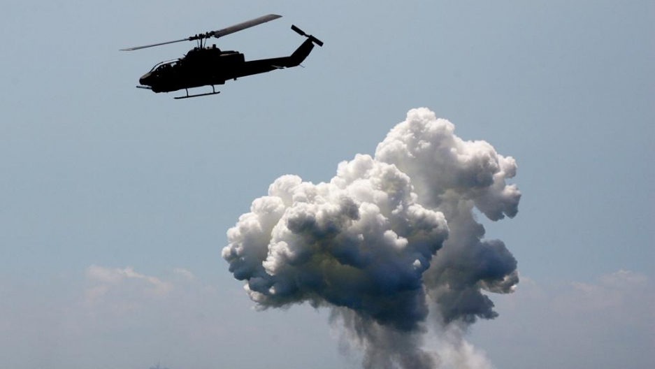 A US-made AH-1W Cobra helicopter launches hellfire missiles during the annual Han Kuang No. 22 Military Exercise in Ilan county, 49 miles west of Taipei July 20, 2006