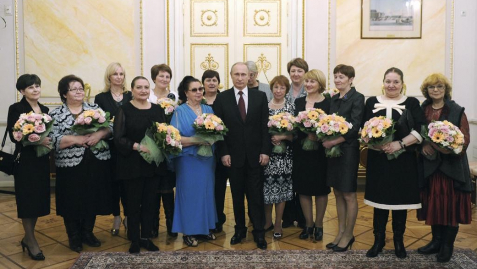 Russian President Vladimir Putin celebrates International Women's Day at the Kremlin in Moscow March 8, 2015.
