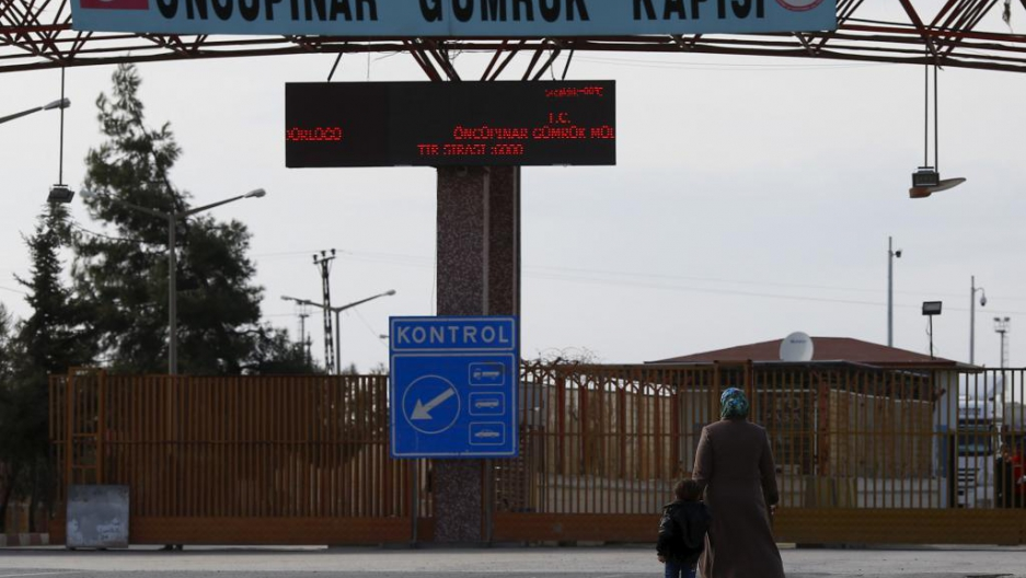 Syrians walk at the Oncupinar crossing on the border with Syria in the southeastern city of Kilis, Turkey on Feb. 10.