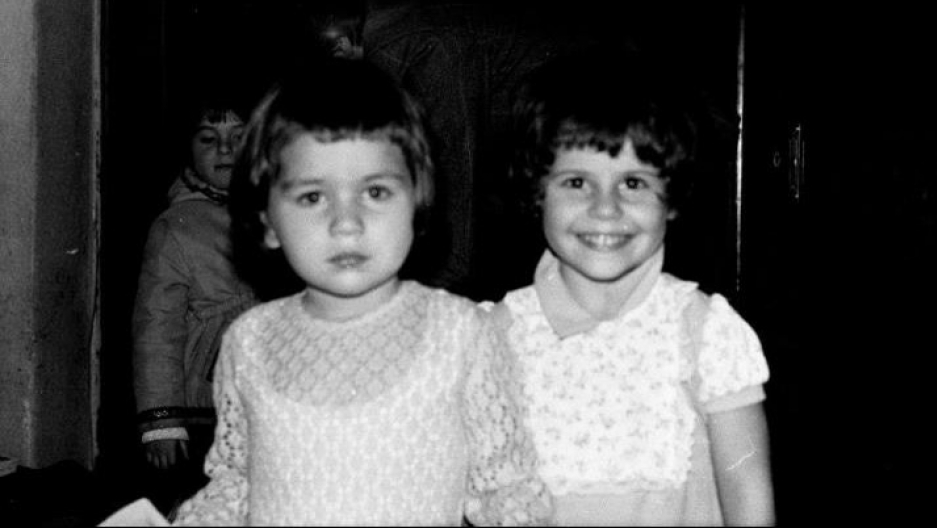 Rukmini, 5 years old and scowling next to her best friend Ilinca before fleeing Romania circa 1979 or 1978.