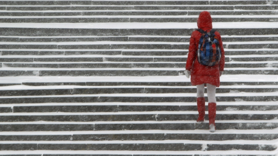 A woman walks in the snow in Moscow December 26, 2011.