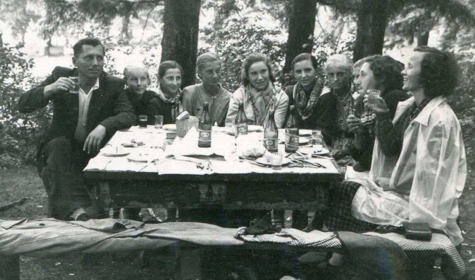Ukrainians Yuriy and Varvara Balega at a picnic table, with some of Varvara's students in between.