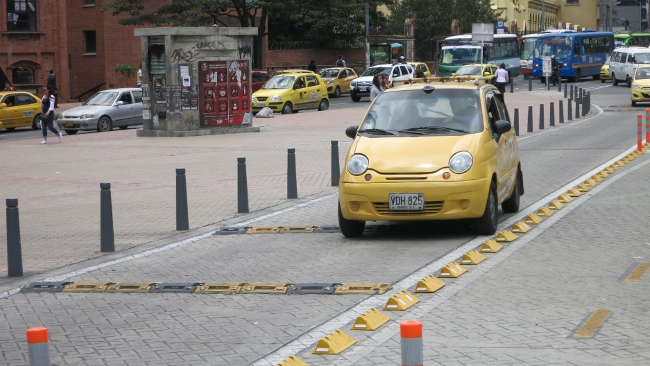 Bogotá has taken a number of design steps to slow cars down and keep them separate from pedestrians and cyclists.