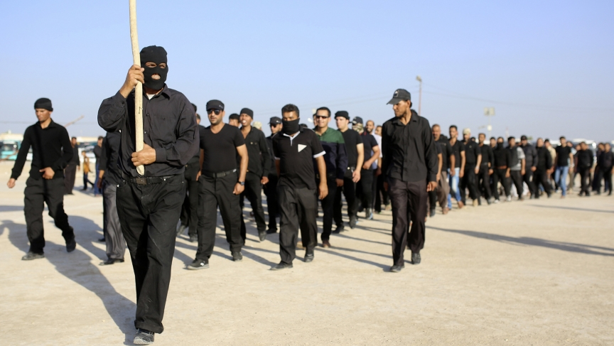 Mehdi Army fighters loyal to Shi'ite cleric Moqtada al-Sadr march during a military-style training in the holy city of Najaf, June 16, 2014.