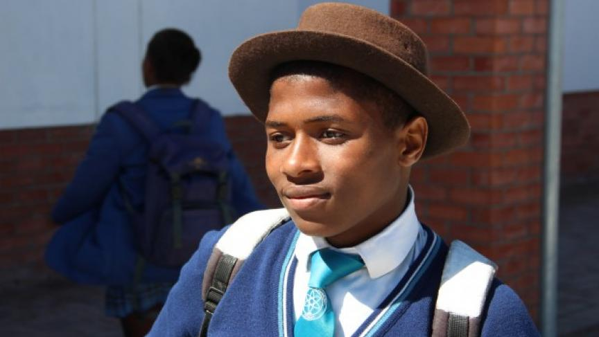 Sive wears a hat to symbolize his transition to manhood.