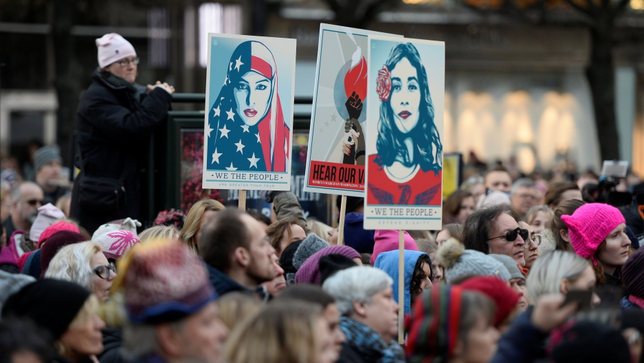 Protesters carrying banners and placards take part in a Women's March in Stockholm, Sweden