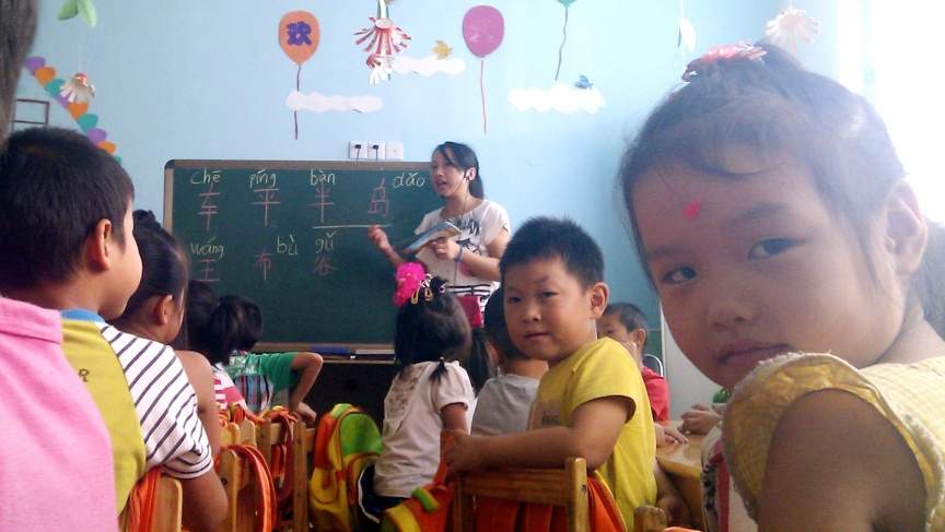 The children of migrant workers are taught Mandarin at a school in Shanghai. Many speak a regional dialect at home, and some don't speak Mandarin at all when they arrive for the first day of class.