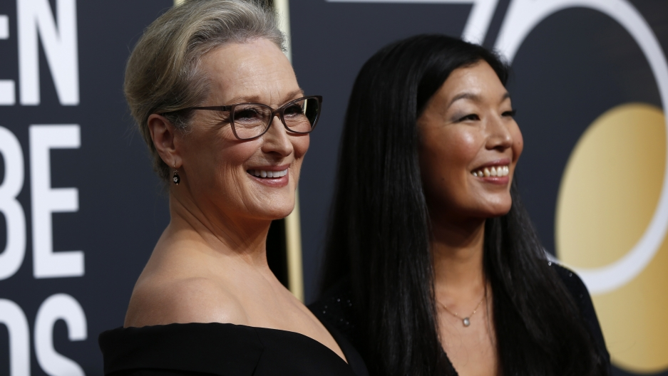Actress Meryl Streep (L) and the director of the National Domestic Workers Alliance, Ai-jen Poo, at the 75th Golden Globe Awards.