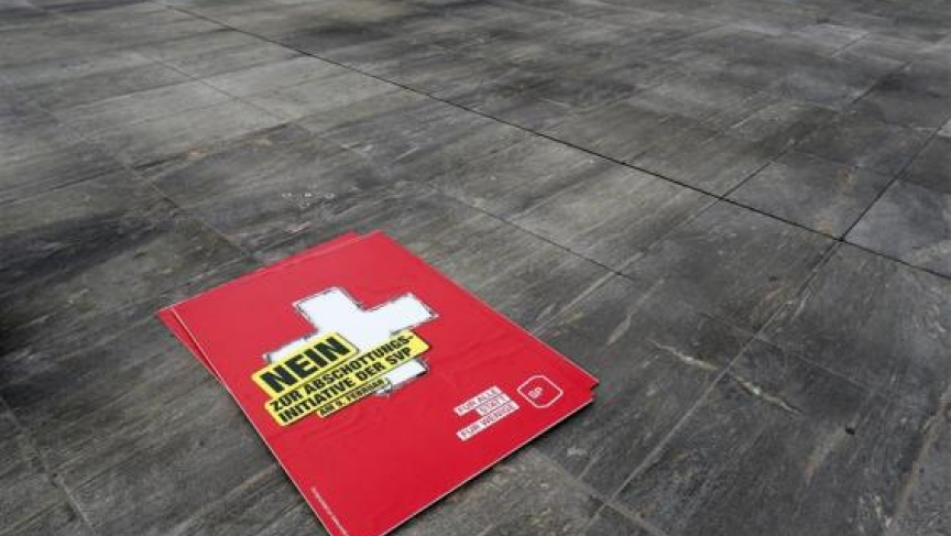 """A poster against the """"mass immigration initiative"""" of the Swiss Socalist Party SPS is seen on the Federal Square before a campaign in Bern."""
