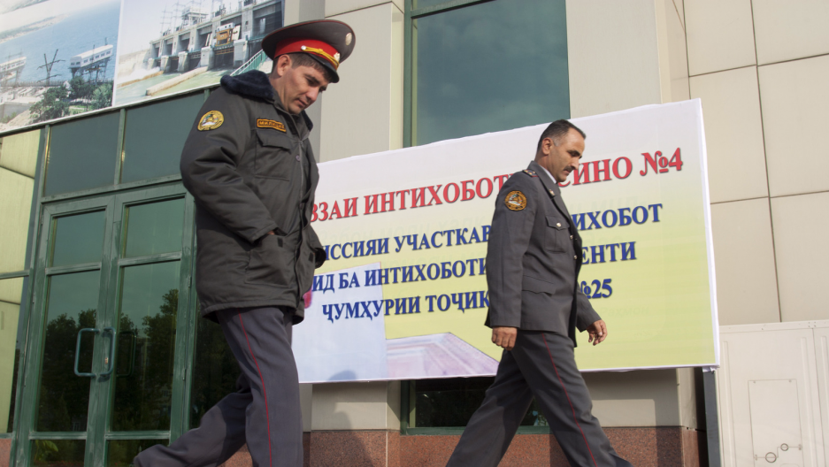 Police officers walk outside a polling station in Dushanbe, Tajikistan, Nov. 1, 2013. Tajikistan has recently announced a registry of allegedly gay citizens.