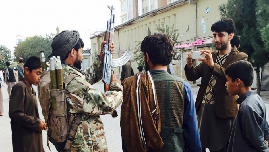 Taliban fighter, second from left, in Kunduz, Afghanistan, on Tuesday, a day after the insurgents took control of the city.