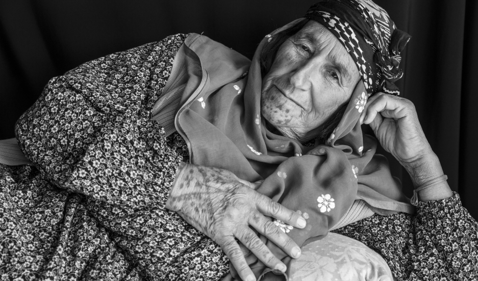 "Safi Haso, about 70 years old, from Girik village of Kobani. ""We are probably the last generation that has tattoos,"" she says. ""All Kurdish women had them."" In addition to facial, hand and neck tattoos, Haso has tattooed her own breast with circles around"