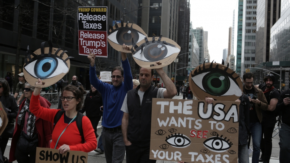 People march demanding U.S. President Donald Trump release his tax returns, in New York, April 15, 2017.