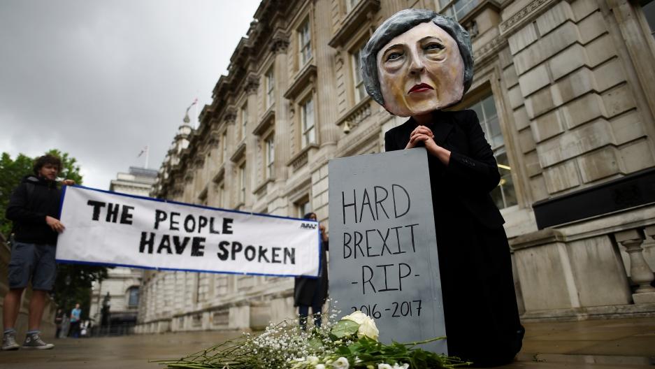 Protestor wearing a Theresa May mask