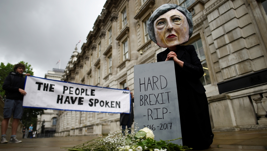 Protestor wearing a Theresa May mask