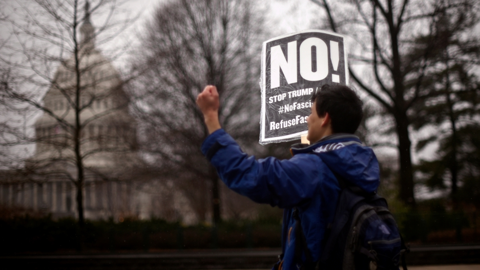 A protester organized by RefuseFascism.org participates in a demonstration outside the US Supreme Court