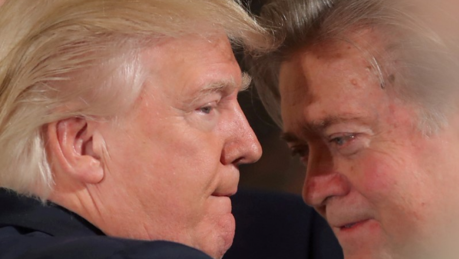 President Donald Trump talks to chief strategist Steve Bannon during a swearing in ceremony for senior staff at the White House in Washington, Jan. 22, 2017.