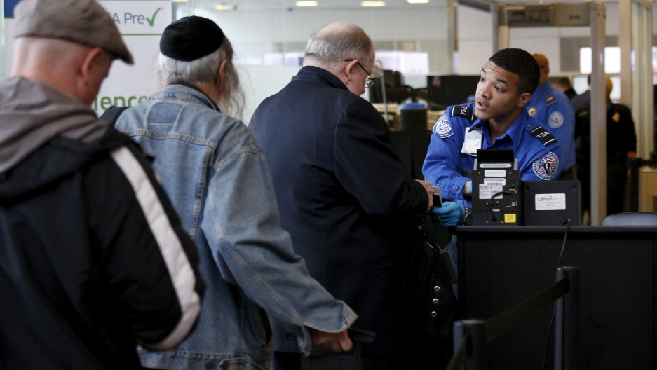 Travelers make their way through a TSA checkpoint at Reagan National Airport in Washington