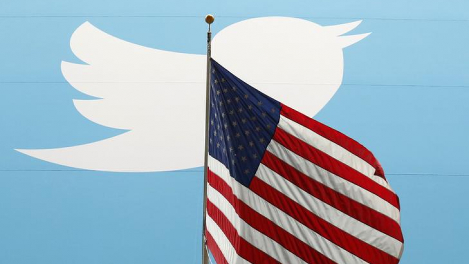 The white bird Twitter logo appears behind the American flag.