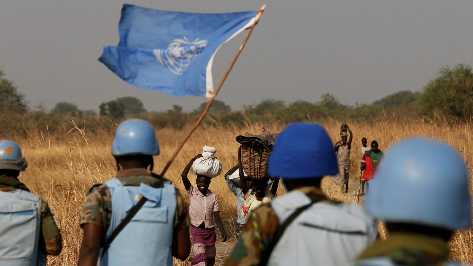 United Nations peacekeepers meet women and children on their path during a patrol near Bentiu, northern South Sudan, Feb. 11, 2017.